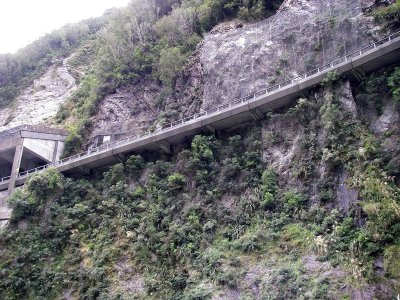 Half bridge and cantilevered road construction